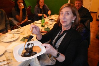 Also in Madrid,  guests visited El Txok and ate squid cooked in its own ink. Pictured in front is Ana Pérez-Gironés,  resident director.