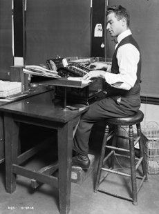 Engineer working at an adding machine
